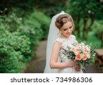 beautiful blonde bride poses... | Shutterstock . vector #734986306