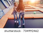 little pretty girls having fun... | Shutterstock . vector #734992462