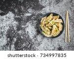 asian dumplings in bowl ... | Shutterstock . vector #734997835