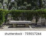 white stone bench along a... | Shutterstock . vector #735017266