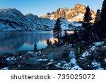 sunrise on banner peak above... | Shutterstock . vector #735025072