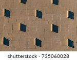 stucco wall with shadows.... | Shutterstock . vector #735060028