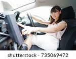 woman using car navigation | Shutterstock . vector #735069472