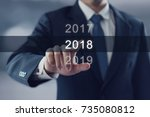 businessman pointing year 2018. ... | Shutterstock . vector #735080812