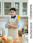 asian young man is cooking | Shutterstock . vector #735084496