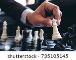 close up of hands confident... | Shutterstock . vector #735105145