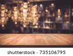 empty of wood table top with... | Shutterstock . vector #735106795