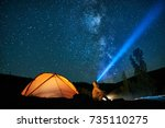 man tourist with flashlight... | Shutterstock . vector #735110275