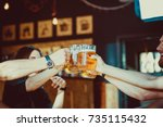 Happy Friends Drinking Beer An...