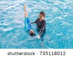 girl learning to swim with... | Shutterstock . vector #735118012
