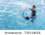 girl learning to swim with... | Shutterstock . vector #735118018
