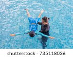 girl learning to swim with...   Shutterstock . vector #735118036