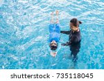 girl learning to swim with... | Shutterstock . vector #735118045