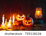 halloween pumpkin with glowing... | Shutterstock . vector #735118126