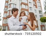 cheerful parents holding their...   Shutterstock . vector #735120502