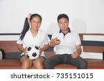 asian family fans soccer... | Shutterstock . vector #735151015