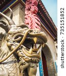 Small photo of Bronze statue of a legendary Chinese dragon with antlers and whiskers at the entrance of the Temple of the Queen of Heaven, Tianjin, China