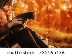 girl and a cat in the autumn... | Shutterstock . vector #735165136