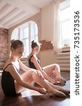 Small photo of Young ballerinas. Pensive ladies in class. Teenage sport, pretty girls stretching. Sensibility from childhood. Gym background, healthy teen lifestyle, femininity concept