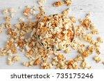 bowl with tasty caramel popcorn ...   Shutterstock . vector #735175246
