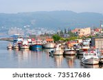 City harbor with boats in Chanakkale, Turkey (opposite side of monument in Dardanelle channel) - stock photo