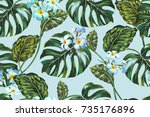 Stock vector beautiful seamless vector floral summer pattern background with tropical flowers jungle leaves 735176896