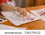 3 year old child sitting at a... | Shutterstock . vector #735179122