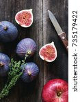 fresh purple figs  thyme and... | Shutterstock . vector #735179422