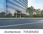 empty road with modern... | Shutterstock . vector #735204202