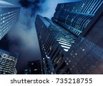 skyscrapers under dark night... | Shutterstock . vector #735218755