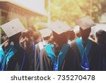 shot of graduation hats during... | Shutterstock . vector #735270478
