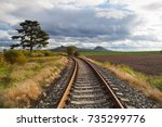 single railway track in rana ... | Shutterstock . vector #735299776