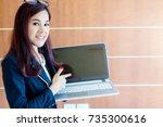 beautiful asian businesswoman... | Shutterstock . vector #735300616