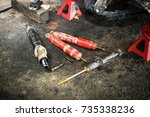 group of old shock absorber of... | Shutterstock . vector #735338236