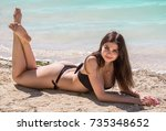 young sexy woman in a black... | Shutterstock . vector #735348652