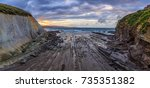 flysch rock formation and beach ... | Shutterstock . vector #735351382