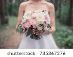 a bouquet in the hands of the... | Shutterstock . vector #735367276