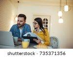 a young couple going through... | Shutterstock . vector #735371356