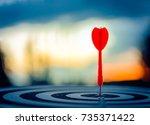 red dart arrow hit in the... | Shutterstock . vector #735371422