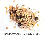 a handful of muesli with dried... | Shutterstock . vector #735379138