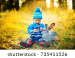 Baby Boy In Autumn Forest With...