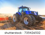 close up work of a tractor on a ... | Shutterstock . vector #735426532