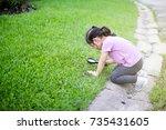 Cute Little Girl Exploring A...