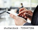 close up of a man using mobile... | Shutterstock . vector #735447286