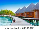 Maldives. A wooden road over ocean - stock photo