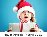 happy toddler girl with a santa ... | Shutterstock . vector #735468382