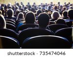 people in the auditorium during ...   Shutterstock . vector #735474046