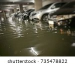 flooding car in  basement... | Shutterstock . vector #735478822