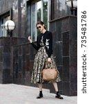 fashion photo  street style... | Shutterstock . vector #735481786