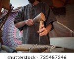craftsman working on stone... | Shutterstock . vector #735487246